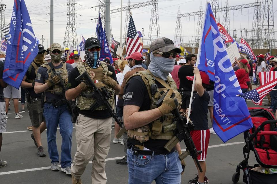 Supporters of President Donald Trump rally outside the Maricopa County Recorder's Office, Friday, Nov. 6, 2020, in Phoenix. (AP Photo/Ross D. Franklin)
