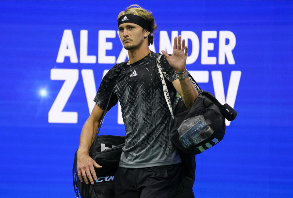Alexander Zverev, of Germany, walks onto the court to play Novak Djokovic, of Serbia, during the semifinals of the US Open tennis championships, Friday, Sept. 10, 2021, in New York. (AP Photo/John Minchillo)