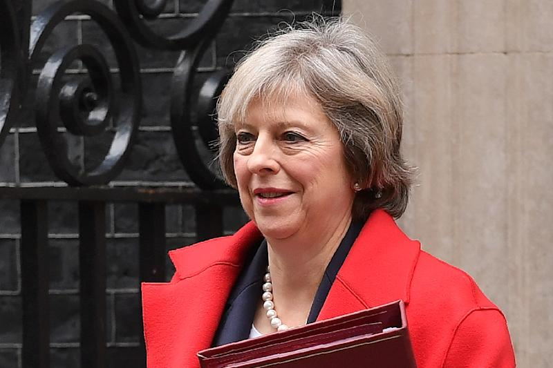 British Prime Minister Theresa May leaves 10 Downing Street in London on November 23, 2016