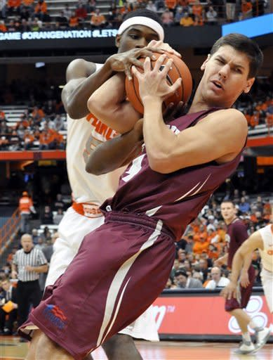 Syracuse's C. J. Fair, left, grapples with Colgate's Luke Roh, right, for the ball during the first half of an NCAA college basketball game in Syracuse, N.Y., Sunday, Nov. 25, 2012. (AP Photo/Kevin Rivoli)