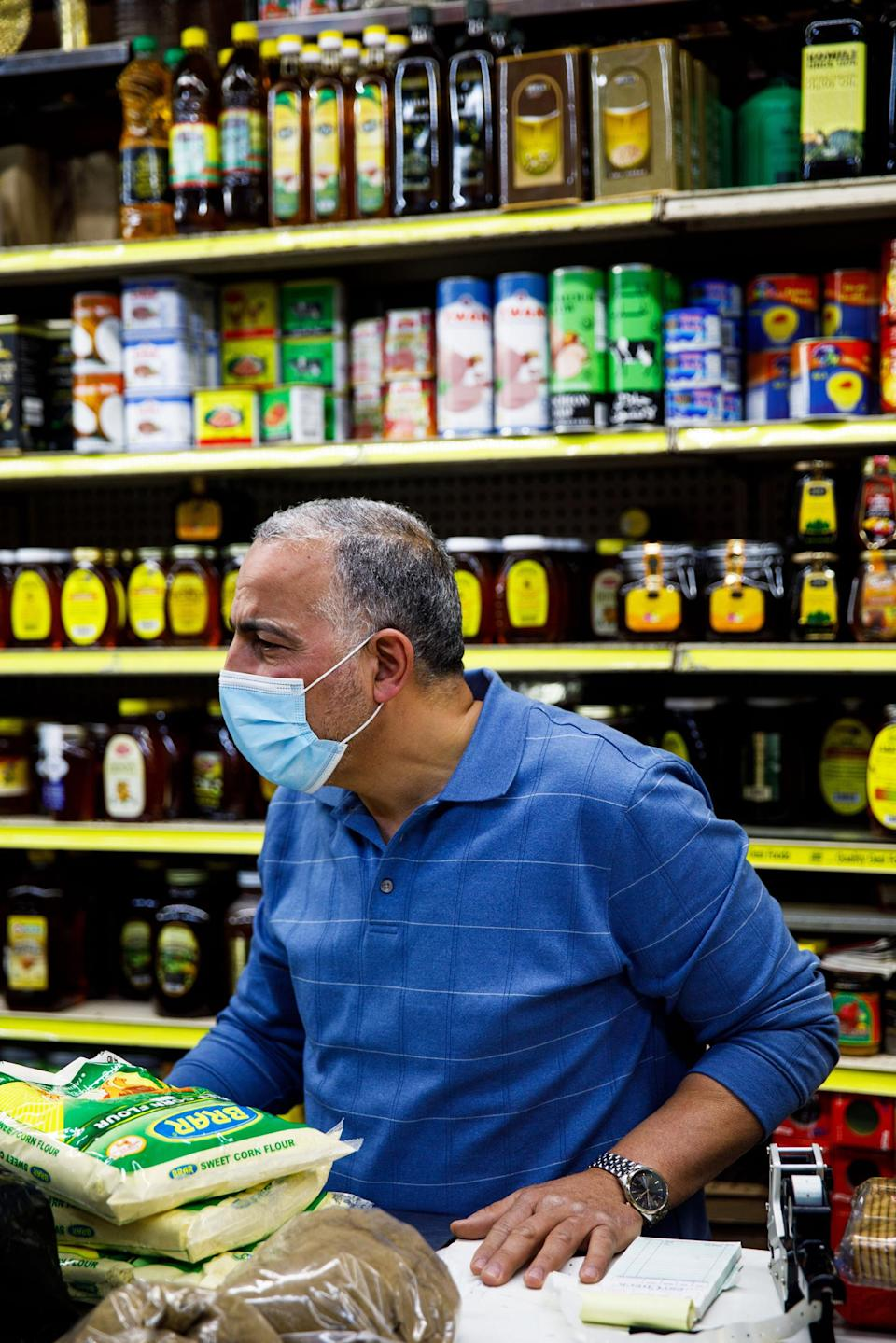 Hamed Nabawy Hamed talks with a customer at his halal grocery store Fertile Crescent in Brooklyn, N.Y., on May 5, 2021. (Julius Constantine Motal / NBC News)