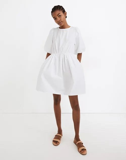 <p>We love the silhouette of this classic <span>Madewell Poplin Crewneck Bubble-Sleeve Mini Dress</span> ($110).</p>