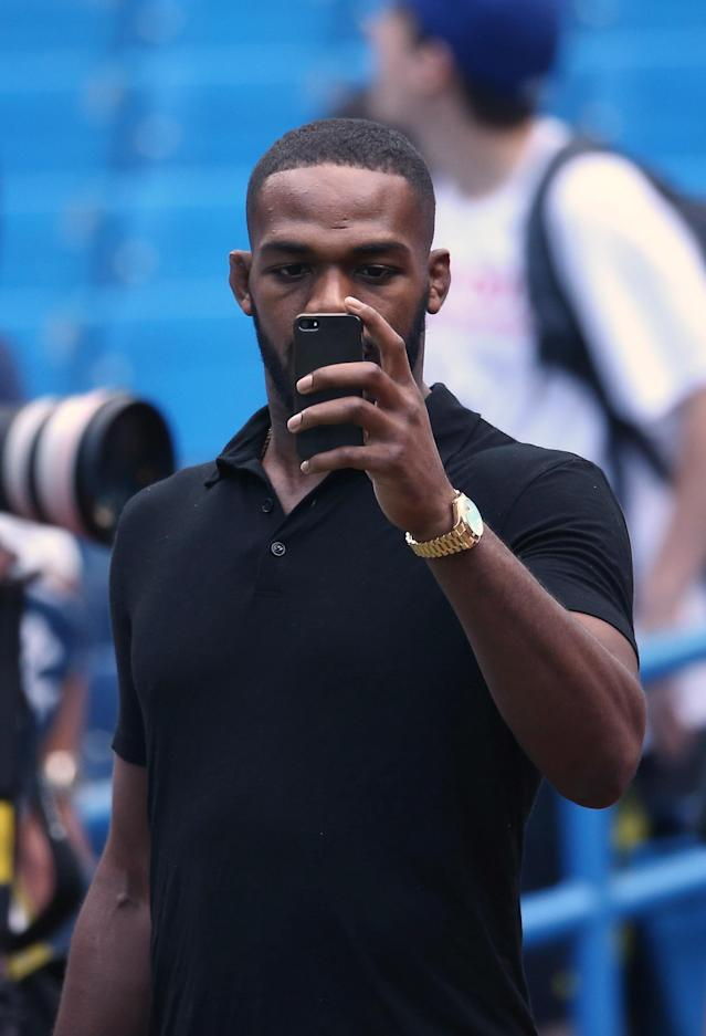 TORONTO, CANADA - SEPTEMBER 18: UFC fighter Jon Jones checks his photo before the Toronto Blue Jays play the New York Yankees on September 18, 2013 at Rogers Centre in Toronto, Ontario, Canada. (Photo by Tom Szczerbowski/Getty Images)
