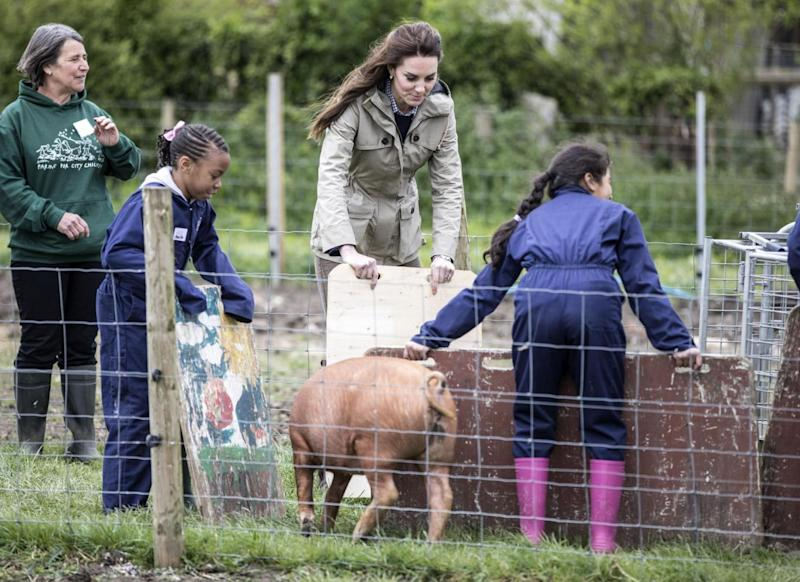 Kate helped herd pigs at one point during the visit (Richard Pohle/The Times/PA )