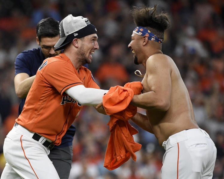 Houston Astros' Alex Bregman, left, and Yuli Gurriel celebrate their clinching of the AL West crown after a baseball game against the Los Angeles Angels, Sunday, Sept. 22, 2019, in Houston. (AP Photo/Eric Christian Smith)
