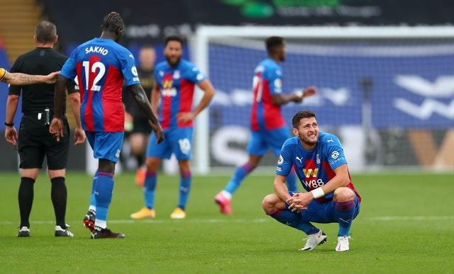 Crystal Palace's Joel Ward (right) sits dejected after the defeat by Everton