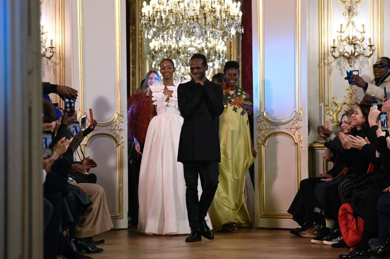 Making history: A visibly moved Cameroonian fashion designer Imane Ayissi at the end of his debut Paris haute couture show