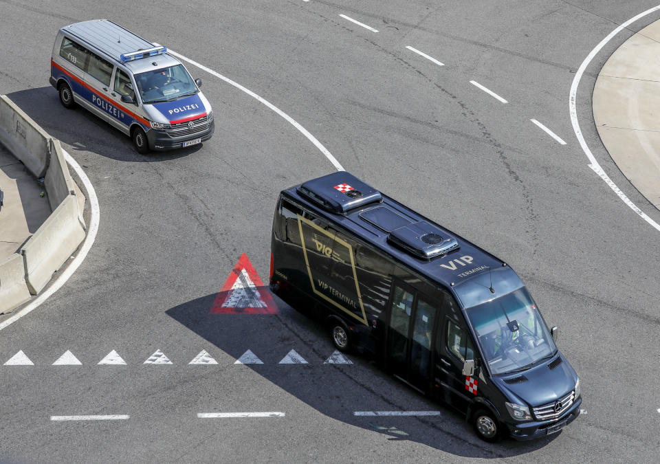 Belarusian Olympic sprinter Krystsina Tsimanouskaya is assumingly taken away in a black van after her arrival at Schwechat International Airport in Vienna Austria, Wednesday, Aug. 4, 2021. Tsimanouskaya plans to seek refuge in Europe after accusing team officials of trying to force her to leave the Tokyo Games early. (AP Photo/Lisa Leutner)