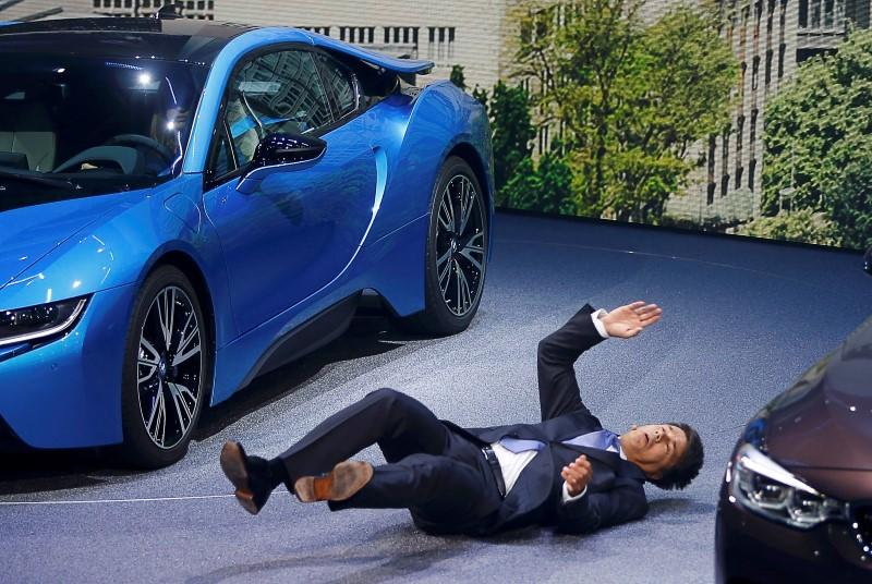 BMW CEO Krueger collapses at a presentation during the media day at the Frankfurt Motor Show (IAA) in Frankfurt