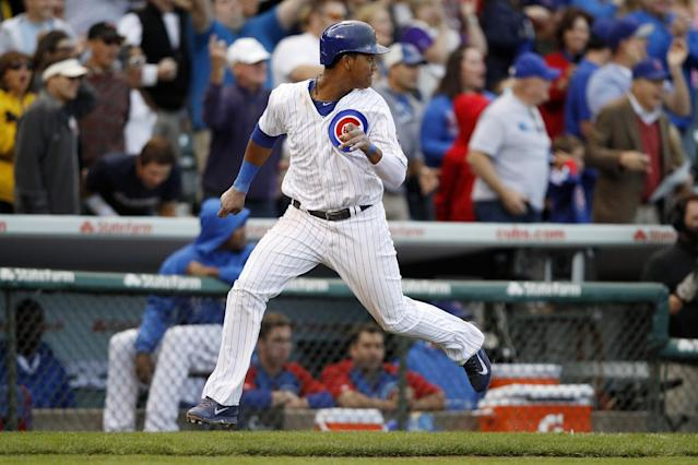 Chicago Cubs' Starlin Castro safely reaches home on a hit by Anthony Rizzo during the eighth inning of a baseball game against the Atlanta Braves on Saturday, Sept. 21, 2013, in Chicago. (AP Photo/Andrew A. Nelles)