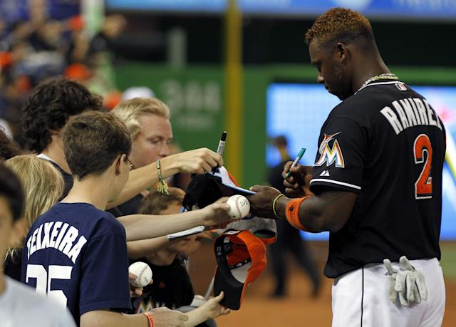 MIAMI, FL - APRIL 13: Third baseman Hanley Ramirez #2 of the Miami Marlins signs autographs before playing against the Houston Astros at Marlins Park on April 13, 2012 in Miami, Florida. (Photo by Marc Serota/Getty Images)