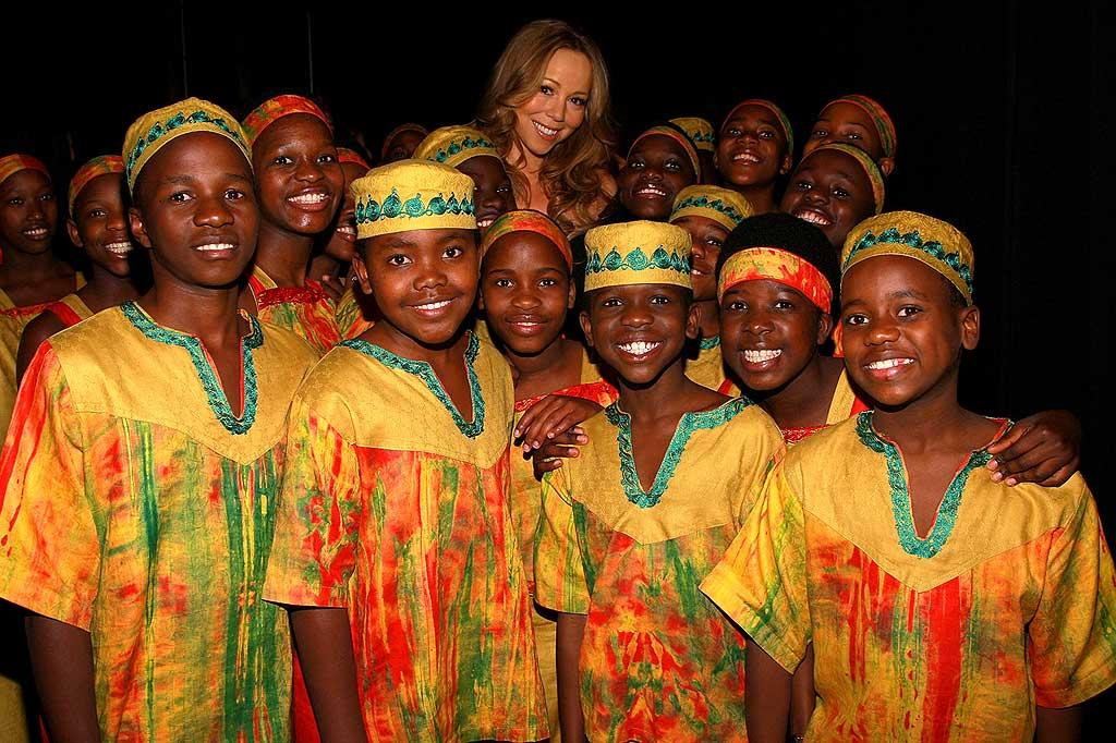 "Mariah Carey and the African Children's Choir pose for a beautiful picture backstage at the event. Dimitrios Kambouris/<a href=""http://www.wireimage.com"" target=""new"">WireImage.com</a> - November 5, 2007"