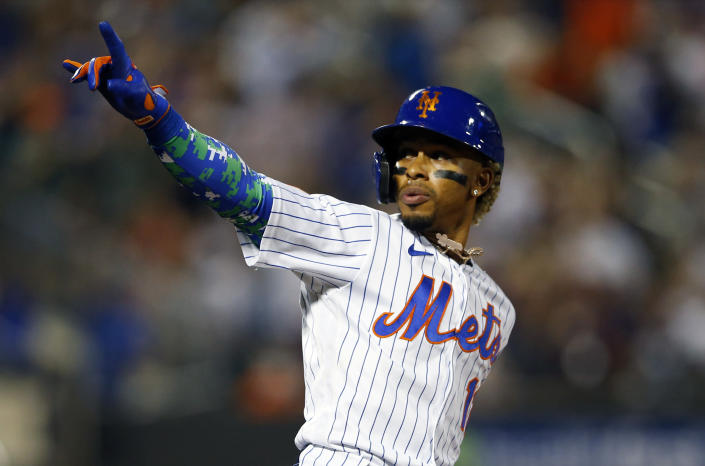 New York Mets' Francisco Lindor reacts after hitting a home run against the New York Yankees during the second inning of a baseball game on Sunday, Sept.12, 2021, in New York. (AP Photo/Noah K. Murray)