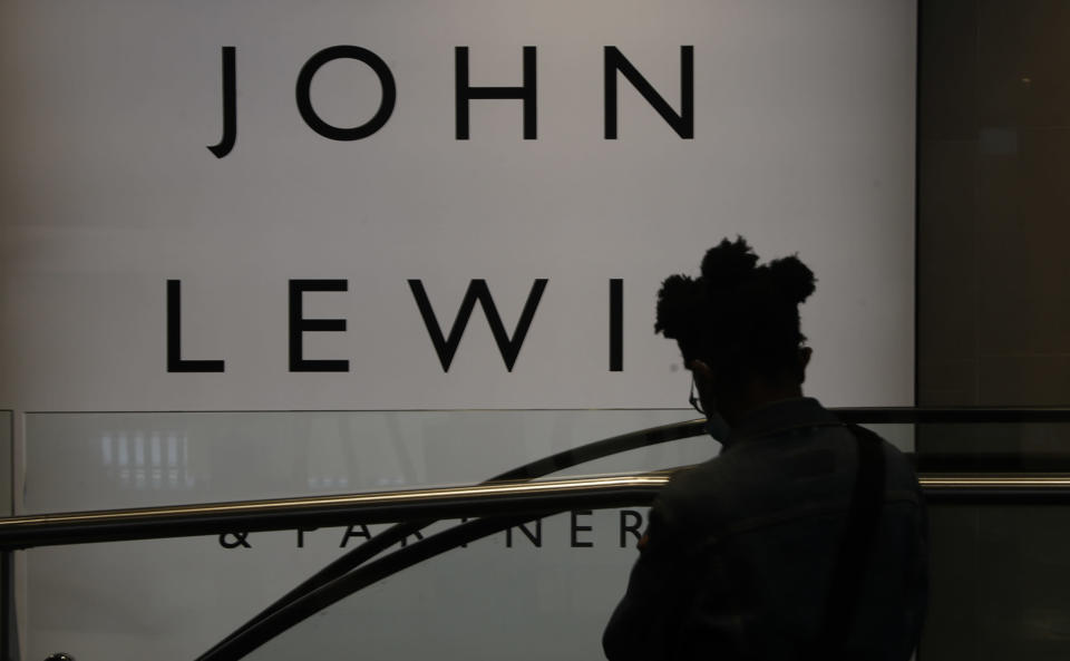 A woman walks by a branch of John Lewis, in London, Thursday, July 16, 2020.Unemployment across the U.K. has held steady during the coronavirus lockdown as a result of a government salary support scheme, but there are clear signals emerging that job losses will skyrocket over coming months. The Office for National Statistics said Thursday there were 649,000 fewer people, or 2.2%, on payroll in June when compared with March when the lockdown restrictions were imposed. (AP Photo/Alastair Grant)