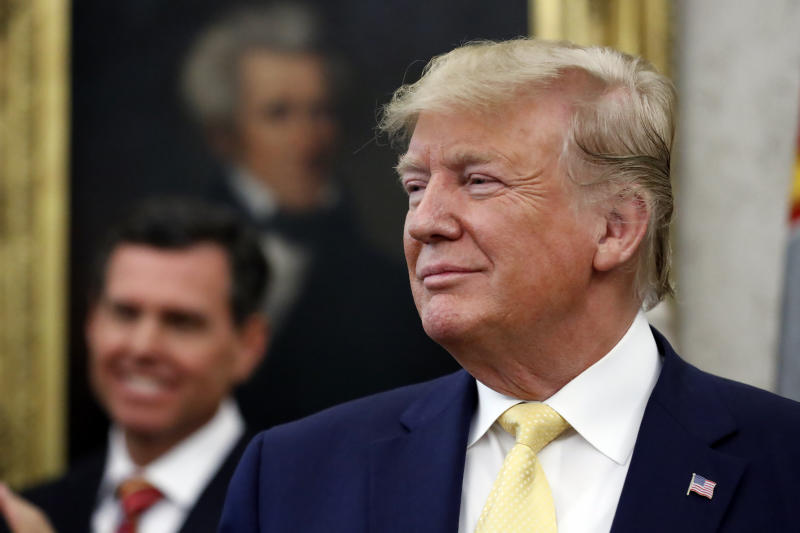 President Donald Trump listens before awarding the Presidential Medal of Freedom to economist Arthur Laffer, Wednesday June 19, 2019, in the Oval Office of the White House in Washington. (AP Photo/Jacquelyn Martin)