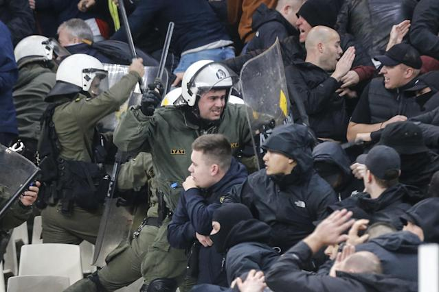 Police had to intervene on multiple occasions of fan violence at the Ajax-AEK Champions League match. (Getty)