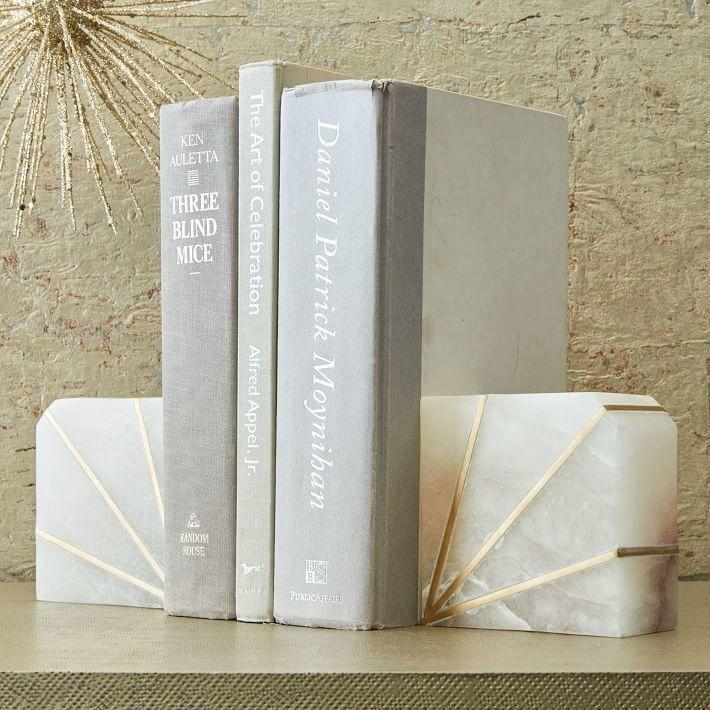 "<i>Buy them from <a href=""https://www.westelm.com/products/stone-bookend-alabaster-d4203/"" target=""_blank"">West Elm</a> for $79 for a set of two. </i>"