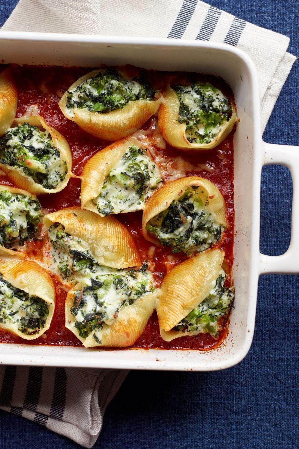 """<p>Vegetarian or non-vegetarian, these cheesy stuffed shells are a classic dish that everyone will go nuts over.</p><p><a href=""""https://www.womansday.com/food-recipes/food-drinks/recipes/a11565/vegetable-three-cheese-stuffed-shells-recipe-123003/"""" rel=""""nofollow noopener"""" target=""""_blank"""" data-ylk=""""slk:Get the Vegetable and Three-Cheese Stuffed Shells recipe."""" class=""""link rapid-noclick-resp""""><em>Get the Vegetable and Three-Cheese Stuffed Shells recipe.</em></a></p>"""