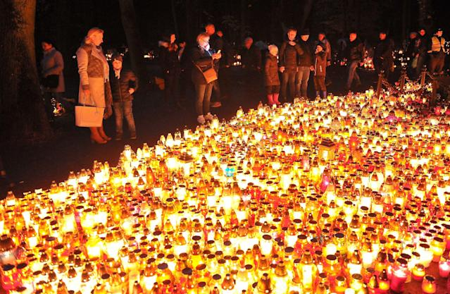 <p>Candles burn on All Saints' Day at the Central Cemetery in Szczecin, Poland, Nov. 1, 2017. People all over Poland visit the graves of beloved ones and leave candles and flowers on them.The cemetery in Szczecin is considered to be the largest necropolis in Poland. (Photo: Marcin Bielecki/EPA-EFE/REX/Shutterstock) </p>