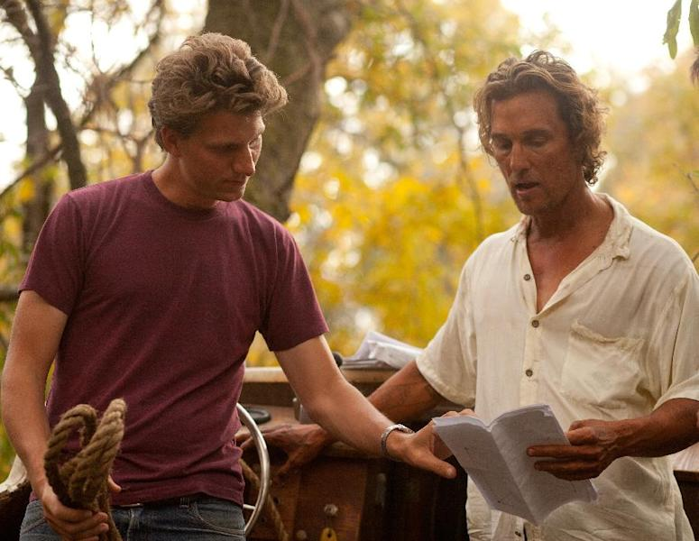 "This film publicity image released by Roadside Attractions shows director Jeff Nichols, left, with actor Matthew Mc Conaughey on the set of ""Mud."" Nichols fashions a Mark Twain-esque Mississippi River tale with some big Hollywood names, including Matthew Mc Conaughey and Reese Witherspoon. (AP Photo/Roadside Attractions, Jim Bridges)"