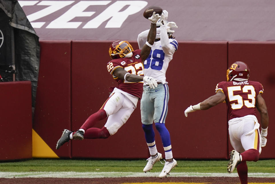 Washington Football Team safety Deshazor Everett (22) stops Dallas Cowboys wide receiver CeeDee Lamb (88) from making a catch. (AP Photo/Patrick Semansky)