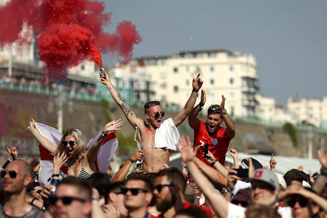 Football fans watch England take on Sweden in The World Cup Quarter Finals at Luna Beach Cinema on Brighton Beach on July 7, 2018 in London, England. (Getty Images)
