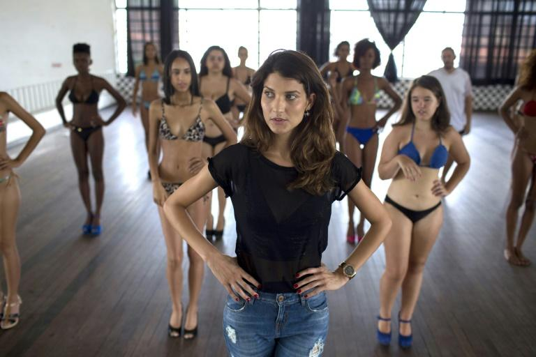 Brazilian model Sandra Passos (front) is giving back, teaching other young Brazilians the basics of modeling and English