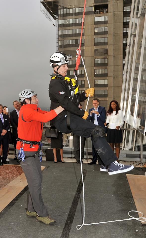 LONDON, UNITED KINGDOM - SEPTEMBER 03:  Prince Andrew, Duke of York is helped by Professor David Hopkins of the Outward Bound Trust after he abseiling down the Shard for charity on September 03, 2012 in London, England. The Prince joined with 40 other people in abseiling down the tallest building for the educational charity The Outward Bound Trust and the Royal Marines Charitable Trust Fund.  (Photo by John Stillwell - WPA Pool/Getty Images)