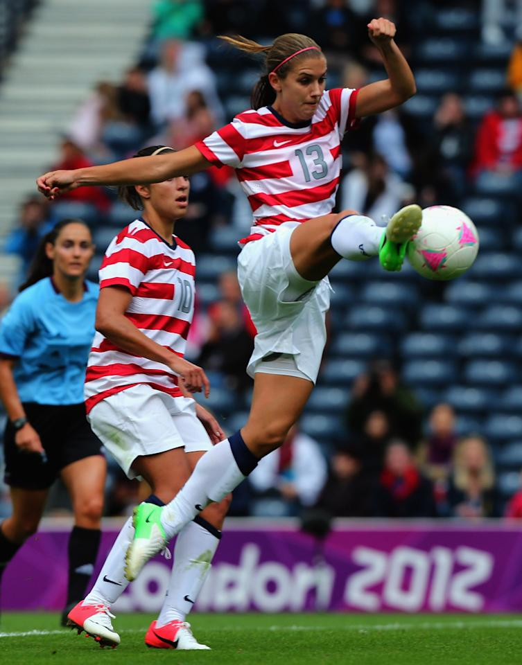GLASGOW, SCOTLAND - JULY 28: Alex Morgan of USA strikes the ball during the Women's Football first round Group G match between United States and Colombia on Day 1 of the London 2012 Olympic Games at Hampden Park on July 28, 2012 in Glasgow, Scotland.  (Photo by Stanley Chou/Getty Images)