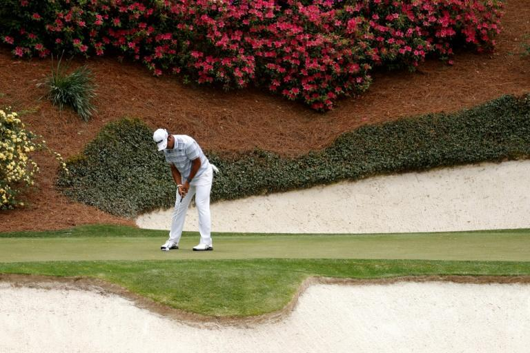 Japan's Hideki Matsuyama putts on the 12th green in the first round of the 2021 Masters at Augusta National Golf Club