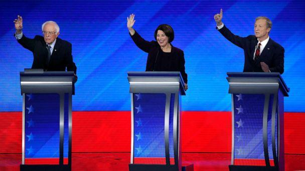 PHOTO: Democratic presidential candidates from left, Sen. Bernie Sanders, Sen. Amy Klobuchar and businessman Tom Steyer, raise their hands to be recognized during a Democratic presidential primary debate, Feb. 7, 2020, in Manchester, N.H. (Elise Amendola/AP, FILE)