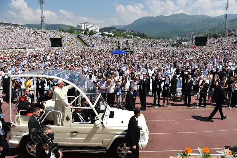 Pope Francis was given a rapturous reception by the 65,000-strong crowd in Sarajevo and his one-day visit to Bosnia comes 20 years after the end of a 1992-95 conflict that ripped the Balkan state apart (AFP Photo/Gabriel Bouys)