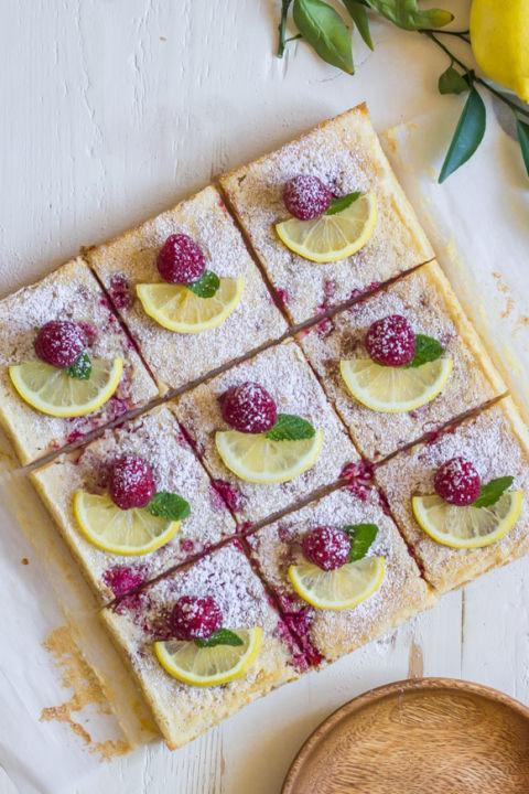"""<p>These beauties feature fresh fruit both in the bars <em>and</em> as a topping.</p><p><strong>Get the recipe at <a href=""""https://lovelylittlekitchen.com/raspberry-lemon-bars/"""" rel=""""nofollow noopener"""" target=""""_blank"""" data-ylk=""""slk:Lovely Little Kitchen"""" class=""""link rapid-noclick-resp"""">Lovely Little Kitchen</a></strong><span><strong>.</strong></span></p>"""
