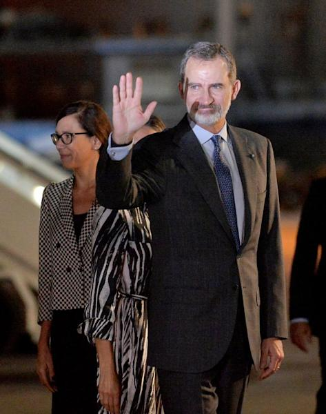 Spain's King Felipe waves as he arrives at the Jose Marti International Airport in Havana