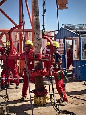 Drilling crew at work on Zion's Megiddo-Jezreel #1 well in Israel.