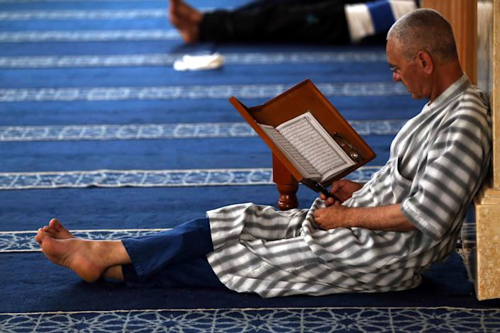 An Algerian Muslim reads the Koran in a mosque in Boufarik, Algeria, on 04/06/2017. The tenth day of the holy Muslim month of Ramadan of the year Hijri From 1438. (Photo by Billal Bensalem/NurPhoto via Getty Images)