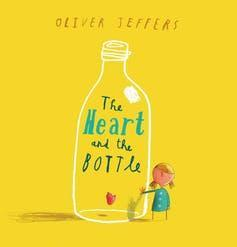 Cover of The Heart and the Bottle featuring a large bottle with a little girl next to it.