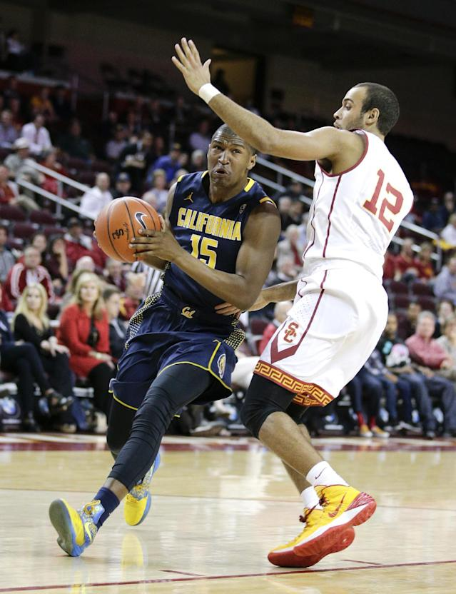 California's Jordan Mathews, left, drives against Southern California's Julian Jacobs during the first half of an NCAA college basketball game Wednesday, Jan. 22, 2014, in Los Angeles. (AP Photo/Jae C. Hong)