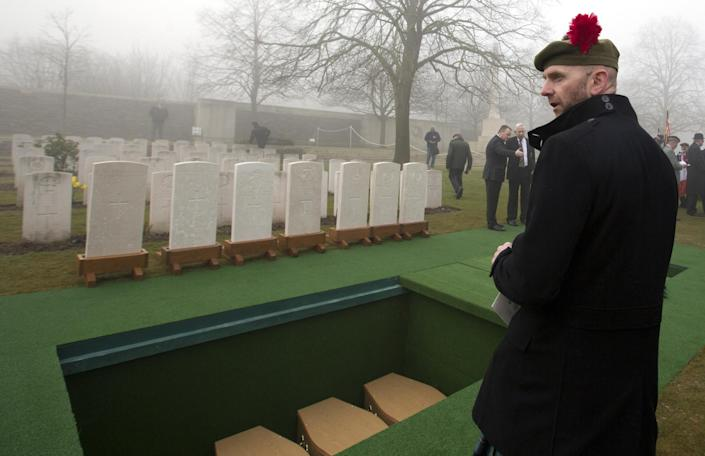 Stephen McLeod, grand nephew of World War One soldier William McAleer looks toward graves during a reburial service at the Loos British World War One cemetery in Loos-en-Gohelle, France on Friday, March 14, 2014. Private William McAleer, of the 7th Battalion, Royal Scots Fusiliers, was killed in action on Sept. 26, 1915 during the Battle of Loos. His body was found and identified in 2010 during routine construction in the area and is being reburied with full military honors along with 19 unknown soldiers. (AP Photo/Virginia Mayo)
