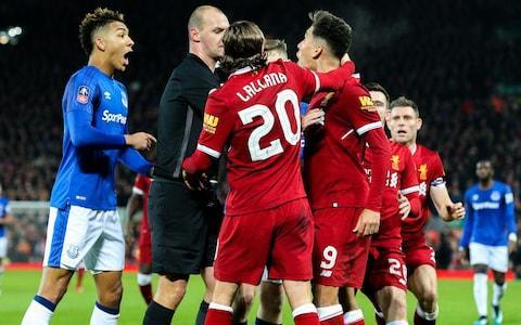 "Liverpool say striker Roberto Firmino has been ""exonerated"" after the Football Association decided not to pursue a charge of racist abuse against Everton's Mason Holgate. After a six-week investigation involving players from both clubs, the FA said there was insufficient evidence to support the allegations. Everton accepted the decision. A separate investigation into alleged homophobic tweets posted by Holgate several years ago is ongoing. Liverpool said Firmino – who spent several hours being questioned at Wembley Stadium during the investigation – had found the process ""hurtful"" and ""difficult"". Team-mates including James Milner, Adam Lallana and Dejan Lovren gave witness statements on Firmino's behalf. Everton skipper Phil Jagielka was also among the players interviewed by the governing body's integrity department. Firmino and Holgate had an altercation during the FA Cup third round Credit: Getty Images In their statement, the FA said no players from either club, nor referee Bobby Madley or his accompanying match officials, heard any racial slur. Independent linguistic experts supported Firmino. ""We are satisfied that the outcome of the process has exonerated the player of using any racist or discriminatory language,"" Liverpool wrote in a statement. ""We thank Roberto for the manner in which he has conducted himself during this difficult process acknowledging that being subjected to such a serious allegation for this length of time has been hurtful to him and his family. ""Both the club and player were in full agreement from the beginning that if an investigation was required it should be a thorough and robust one. The referee tried to diffuse the incident Credit: Getty Images ""Roberto has co-operated fully with the process and shown a willingness to engage and assist throughout, with the only objective being to discover the truth of what happened."" The FA explained their decision in a detailed statement, but were eager not to question the integrity of Holgate's complaint following their deliberations. ""We are completely satisfied that the allegation was made in absolute good faith by Holgate and that there is no suggestion of this being an intentionally false or malicious allegation,"" said the FA. ""We continue to take all allegations of discrimination extremely seriously and would encourage all participants who believe that they have been the subject of or witness to discriminatory abuse to report this through the appropriate channels. Holgate and Everton followed the proper process by reporting the matter to the match officials at the time and subsequently to The FA."" On the process itself, which took over a month, the FA added: ""We took statements from a total of 12 players and officials from both teams, the match referee and the fourth official. None of these individuals directly heard the words alleged to have been said by Firmino. My favourite ever Premier League match ""Firmino was formally interviewed by The FA and provided an alternative account to the words alleged by Holgate. Firmino stated that he had insulted Holgate in Portuguese, but denied categorically using any discriminatory language towards him. ""As part of the investigation, The FA sought the assistance of a Brazilian/Portuguese linguistic specialist on the words alleged. In addition to this, we also obtained multiple angles of video footage, including broadcast and unseen footage showing the incident, which was assessed by two independent Portuguese speaking lip reading experts. The evidence obtained from the experts did not support the allegation. ""We appreciate that this has been a difficult process for both parties, and would like to express our thanks to Mason Holgate and Roberto Firmino as well as both clubs for their assistance, professionalism and full cooperation during this investigation."" Everton issued a dignified response accepting the FA's finding. ""Everton Football Club acknowledges and appreciates the thoroughness of the FA's investigation into the incident that took place during our FA Cup third round game on January 5,"" they said. ""The club welcomes the FA's expression of complete satisfaction that the allegation made by our player, Mason Holgate, was done so in absolute good faith, that proper process was followed and that there is no suggestion of malice or dishonesty on Mason's part. ""The FA has reached its determination and, as a club, we accept this."""