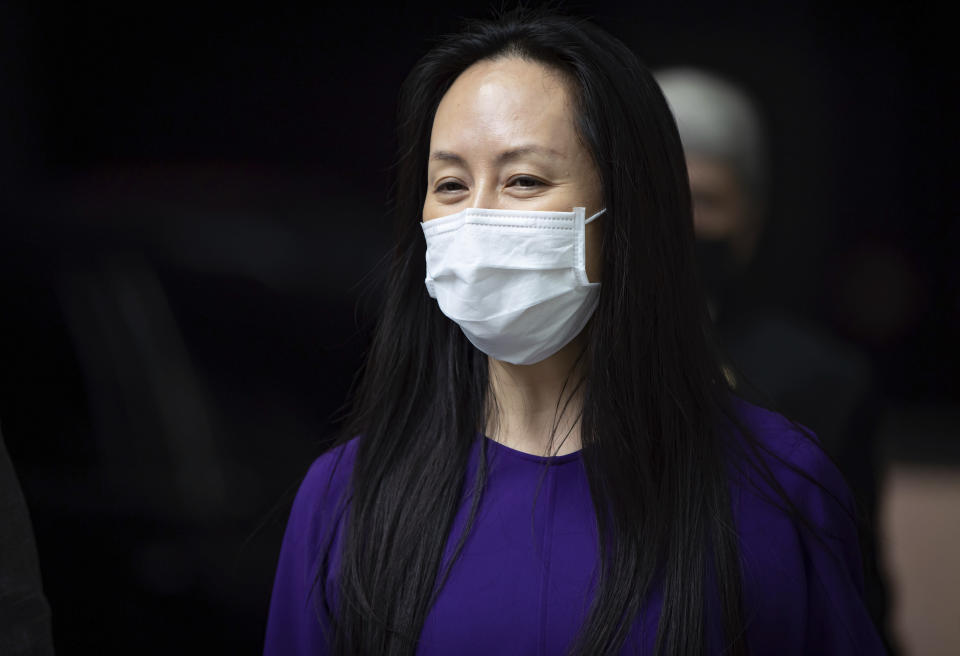 Meng Wanzhou, chief financial officer of Huawei, returns to B.C. Supreme Court after a break in her extradition hearing, Wednesday, Aug. 18, 2021, in Vancouver, British Columbia. (Darryl Dyck/The Canadian Press via AP)