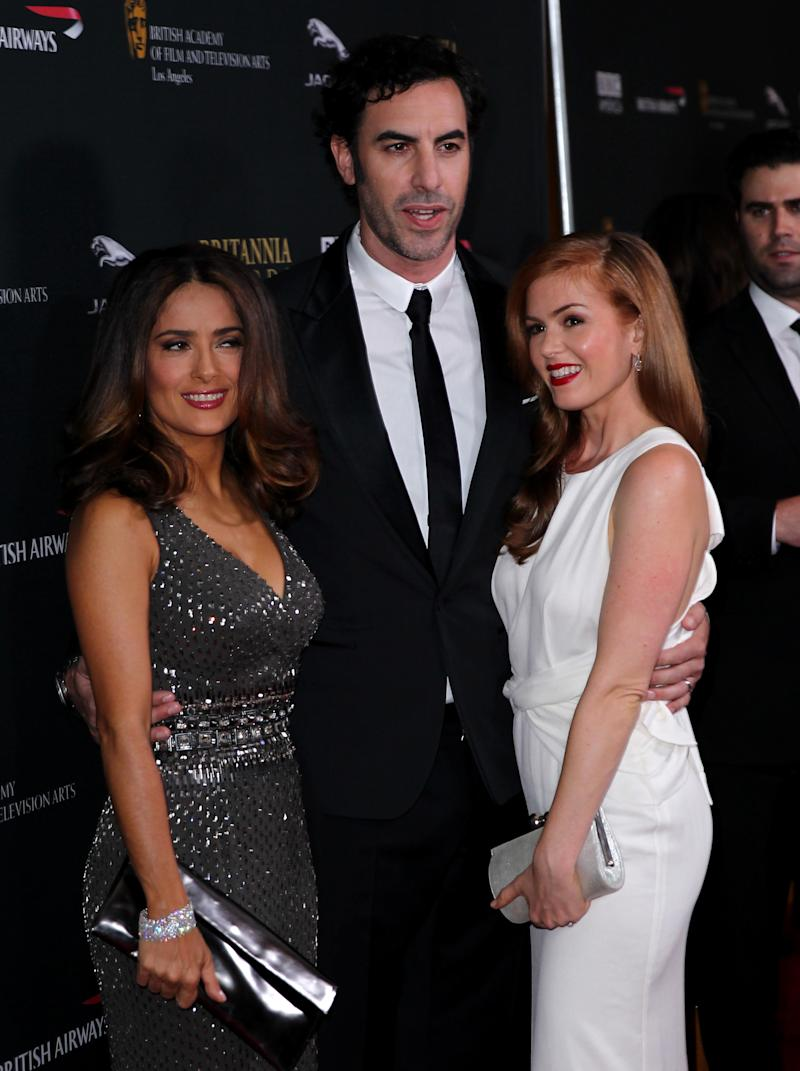 Salma Hayek, left, Sacha Baron Cohen, center, and Isla Fisher pose together at the 2013 BAFTA Los Angeles Britannia Awards at the Beverly Hilton Hotel on Saturday, Nov. 9, 2013 in Beverly Hills, Calif. (Photo by Matt Sayles/Invision/AP)