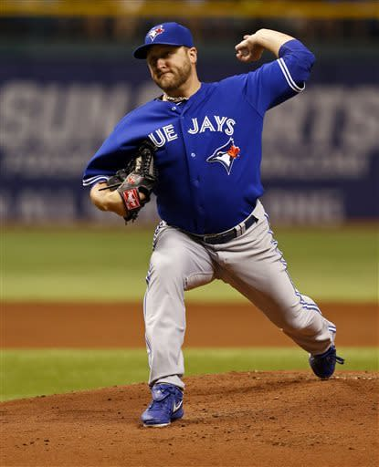 Toronto Blue Jays starting pitcher Mark Buehrle throws during the first inning of a baseball game against the Tampa Bay Rays, Monday, May 6, 2013, in St. Petersburg, Fla. (AP Photo/Mike Carlson)