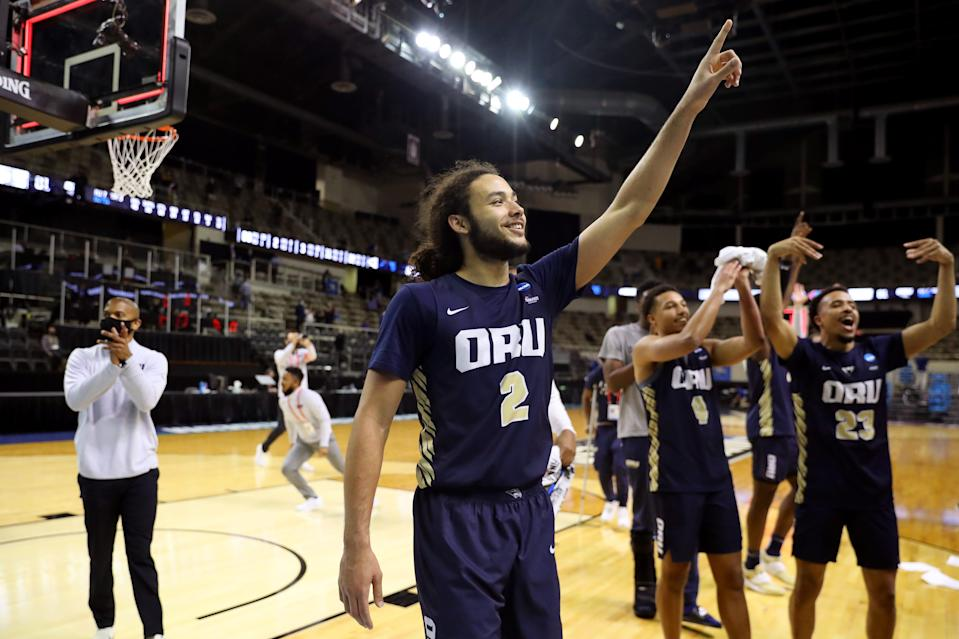 Oral Roberts players celebrate their NCAA Tournament second-round win over Florida.