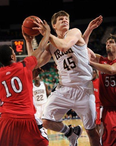 Notre Dame forward Jack Cooley puts up a shot between Rutgers guard Mike Poole, left, and forward Gilvydas Biruta during the second half of an NCAA college basketball game, Wednesday, Feb. 15, 2012, in South Bend, Ind. Cooley was fouled on the play. (AP Photo/Joe Raymond)