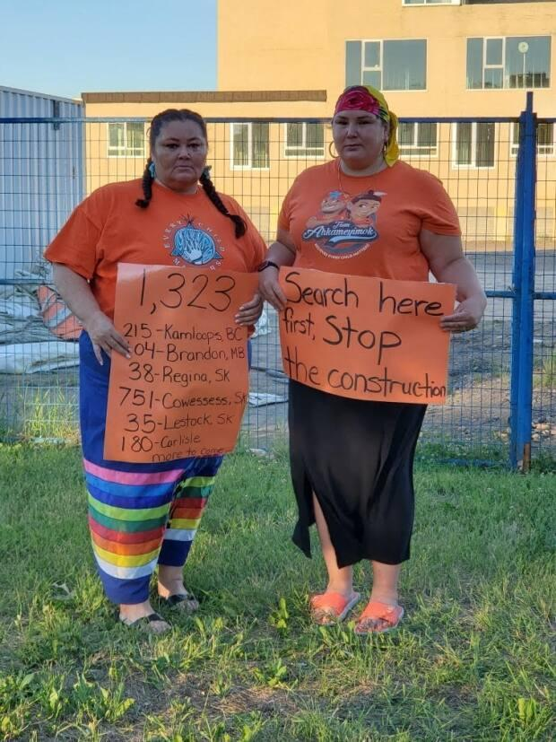 Andrea Jenkins (left) and Lorelei Mullings began a protest and awareness campaign in the Edmonton area about the tragedies of residential schools in the summer, after 751 unmarked graves were discovered near a residential school site on Saskatchewan's Cowessess First Nation. (Submitted by Lorelei Mullings - image credit)