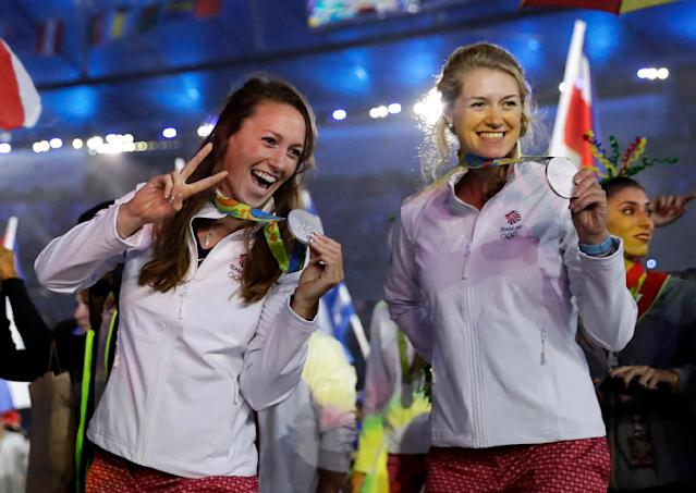 <p>Athletes from Britain show off their medals during the closing ceremony in the Maracana stadium at the 2016 Summer Olympics in Rio de Janeiro, Brazil, Sunday, Aug. 21, 2016. (AP Photo/Matt Dunham) </p>