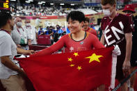 Shanju Bao of Team China celebrates winning the gold medal in the track cycling women's team sprint finals at the 2020 Summer Olympics, Monday, Aug. 2, 2021, in Izu, Japan. (AP Photo/Christophe Ena)