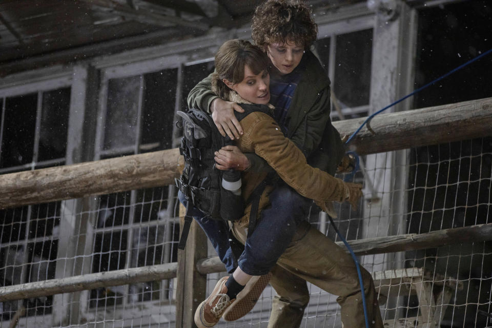 """This image released by Warner Bros. Entertainment shows Angelina Jolie and Finn Little in a scene from """"Those Who Wish Me Dead."""" (Emerson Miller/Warner Bros. Entertainment via AP)"""