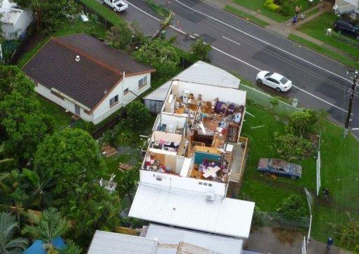 """The devastation caused by a """"mini-tornado"""" after it tore through the Australian city of Townsville, ripping roofs off houses, bringing down power lines and injuring nine people"""